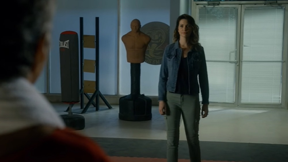 Amanda LaRusso confronting John Kreese at the dojo in the Cobra Kai season 3 trailer