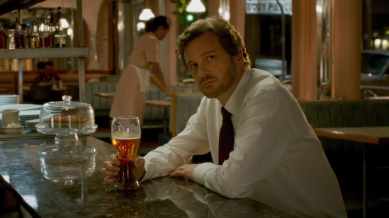 Colin Firth drinking beer