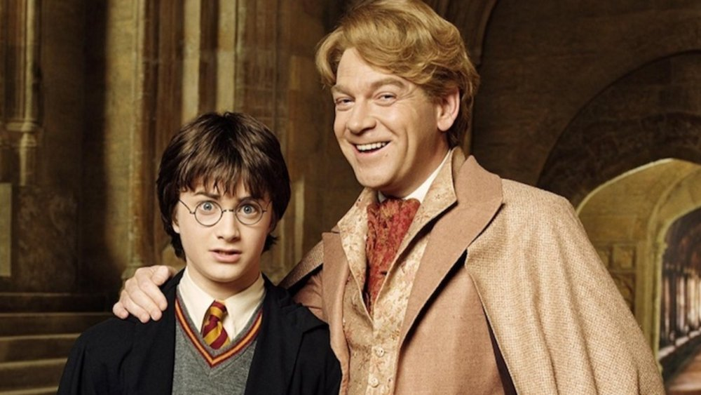Daniel Radcliffe as Harry Potter and Kenneth Branagh as Gilderoy Lockhart in Harry Potter and the Chamber of Secrets