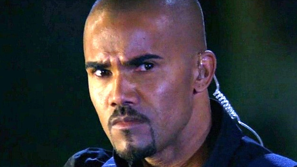 Derek Morgan with earpiece