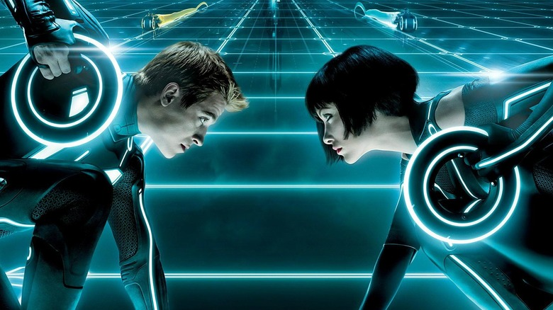 Tron: Legacy promo image featuring Garrett Hedlund and Olivia Wilde as Sam and Quorra