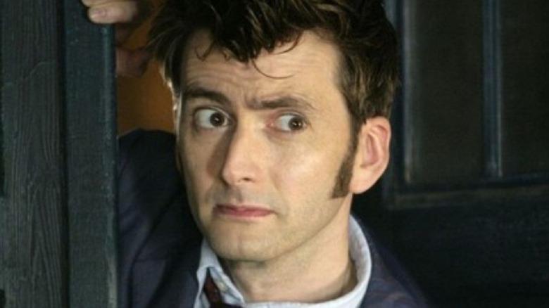 The Tenth Doctor peering