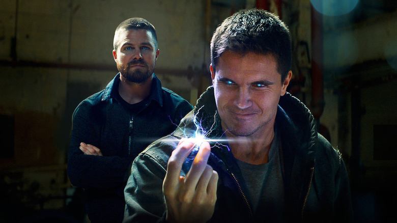 Robbie and Stephen Amell in Netflix's Code 8