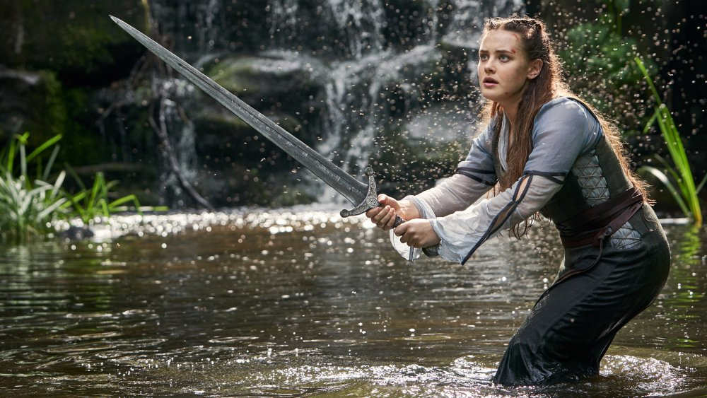 Katherine Langford as Nimue holding Excalibur on Cursed