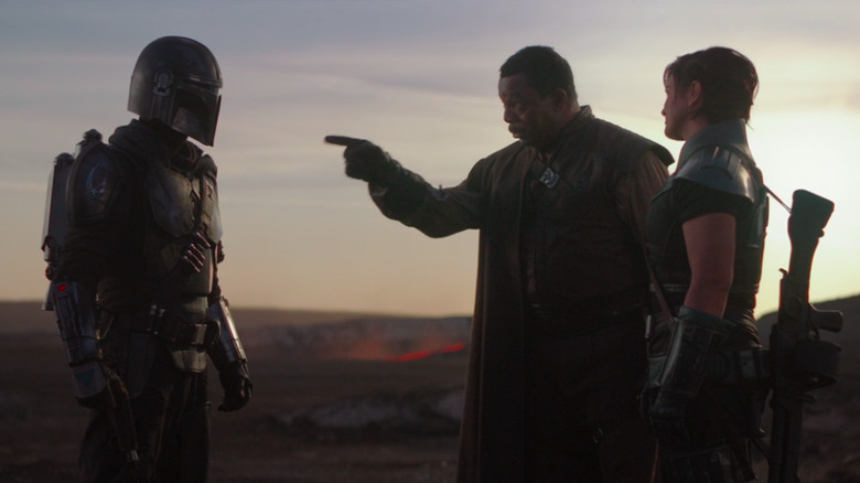 Pedro Pascal, Carl Weathers, and Gina Carano as The Mandalorian, Greef Carga, and Cara Dune