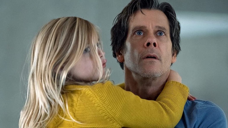 Kevin Bacon's Theo Conroy holds his daughter in You Should Have Left