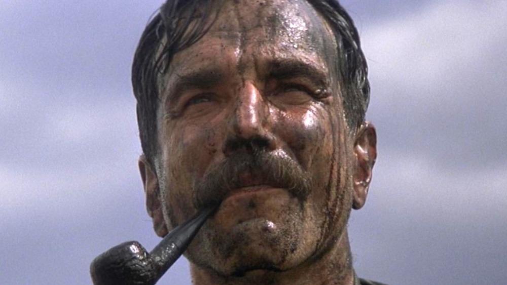 Daniel Plainview smoking a pipe