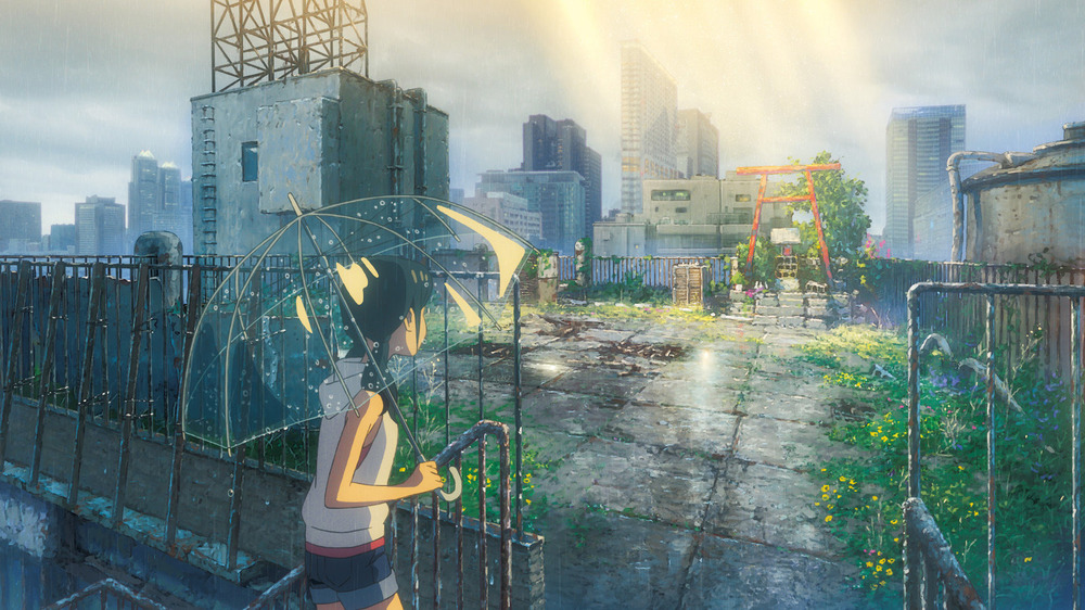 Hina Amano holding umbrella in rooftop garden