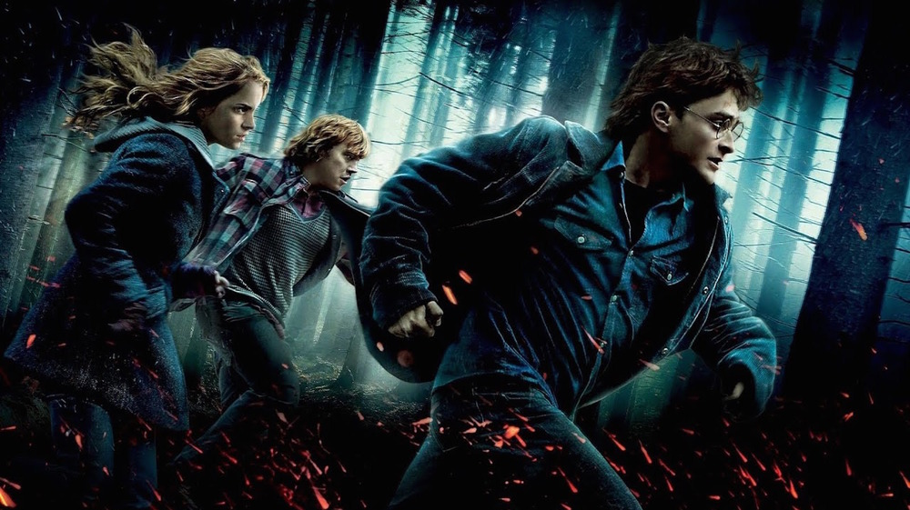 Harry, Ron, and Hermione running