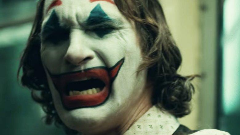 The Debate Over Joaquin Phoenix Heath Ledger As Joker
