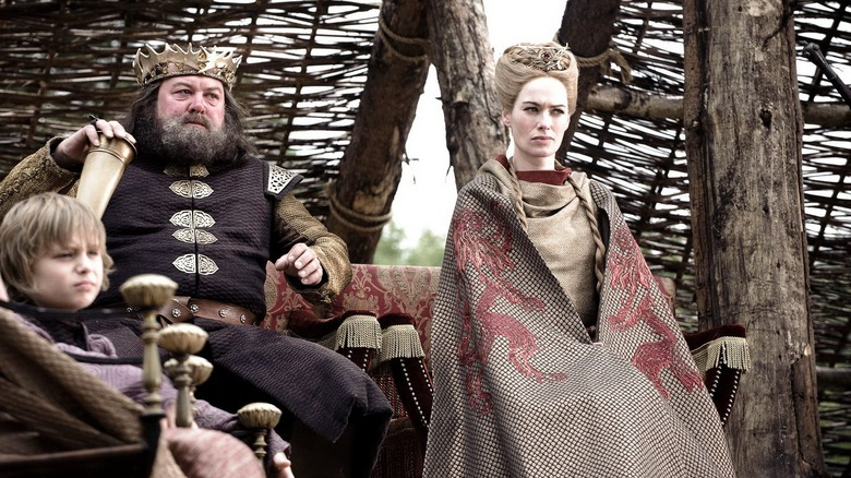 Mark Addy and Lena Headey as Robert Baratheon and Cersei Lannister on Game of Thrones