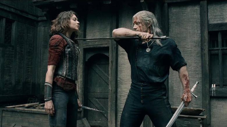 Emma Appleton as Renfri and Henry Cavill as Geralt sparring with swords on The Witcher