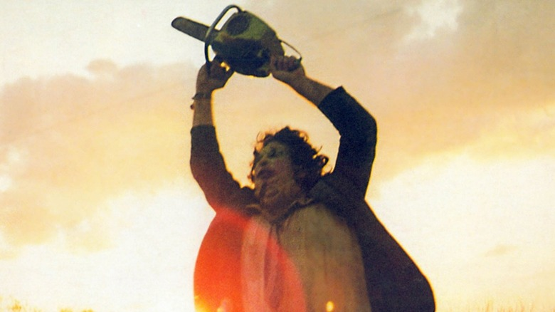 Leatherface waving a chainsaw
