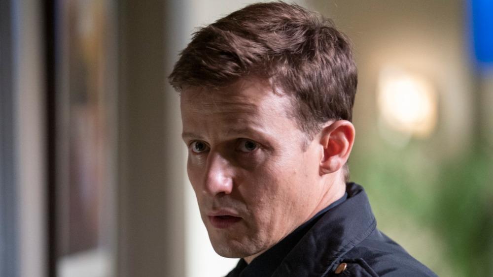 Will Estes wearing cop uniform