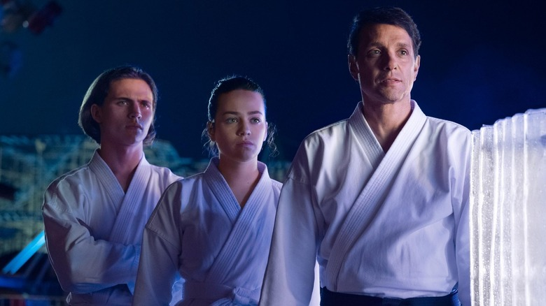 Ralph Macchio as Daniel LaRusso, Mary Mouser as Sam LaRusso, and Tanner Buchanan as Robby Keene on Cobra Kai