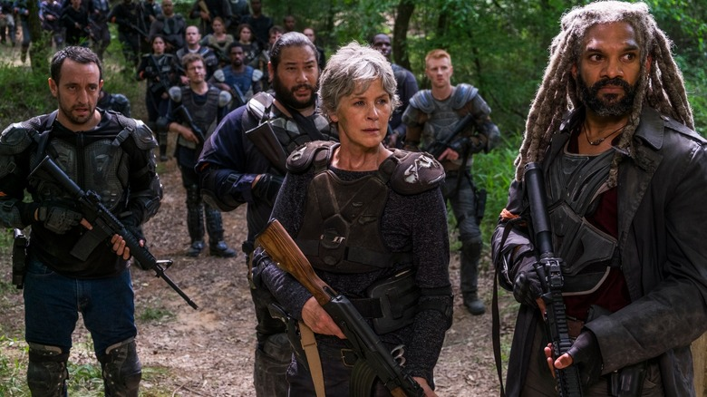 Melissa McBride as Carol, Khary Payton as Ezekiel, Carlos Navarro as Alvaro, and Cooper Andrews as Jerry on The Walking Dead