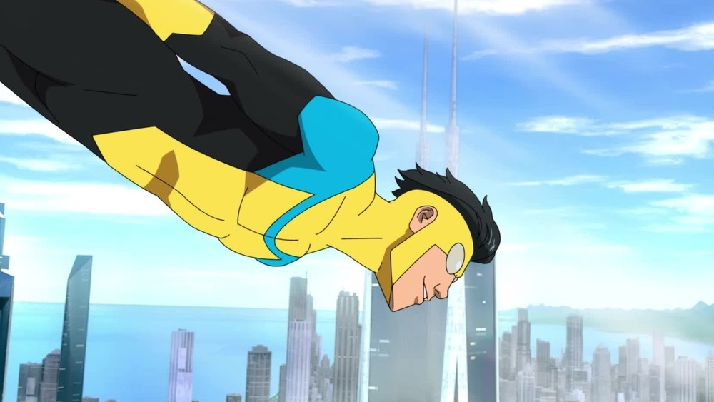 Invincible flying over city