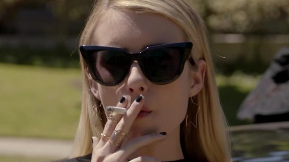 Madison Montgomery smoking a cigarette