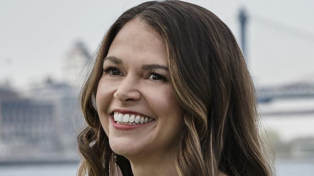 Liza smiling outside