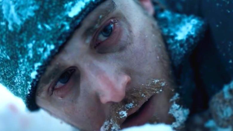 David lying in snow