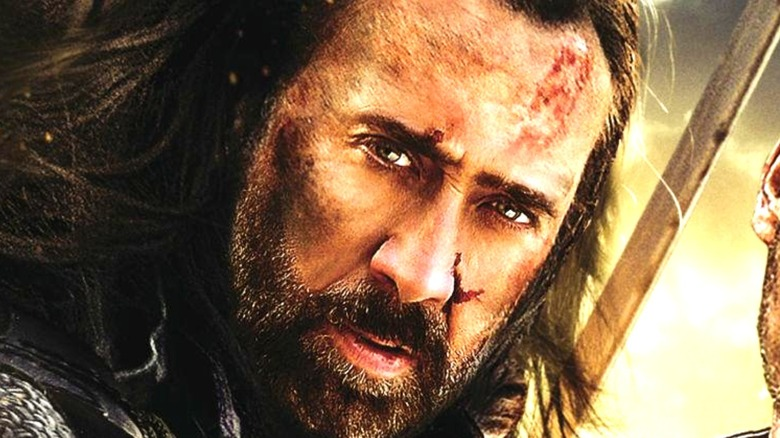 Nicolas Cage as Gallain with long hair in Outcast (2014)