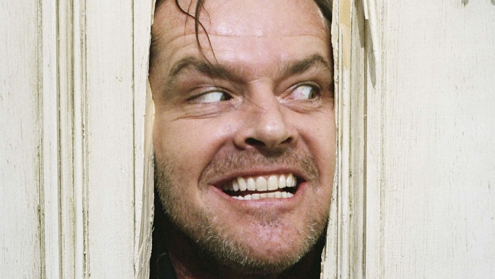 "The Shining going ""Here's Johnny!"""