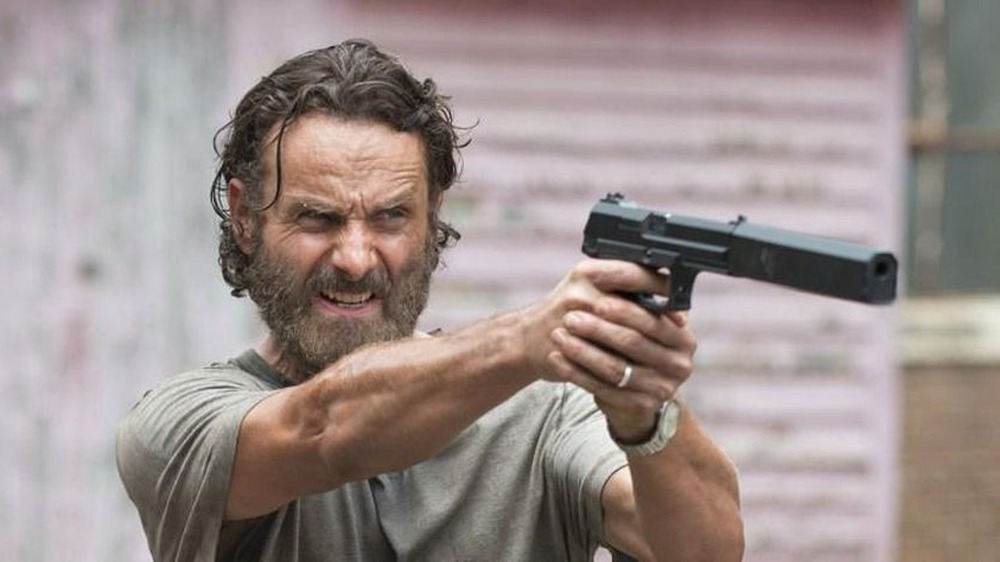 Rick Grimes points a gun in The Walking Dead