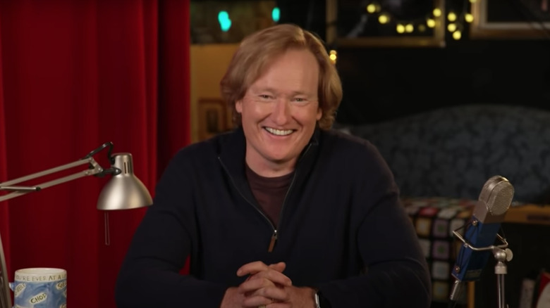 Conan O'Brien smiling and hosting Conan on TBS