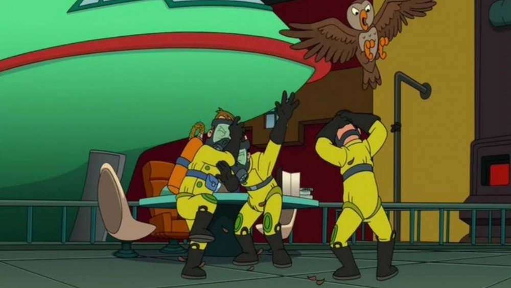 The owl exterminators being attacked by an owl in Futurama