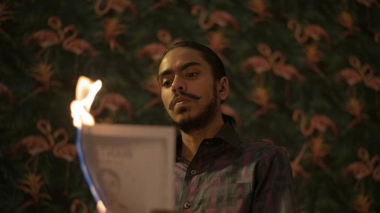 Balram burns his wanted poster