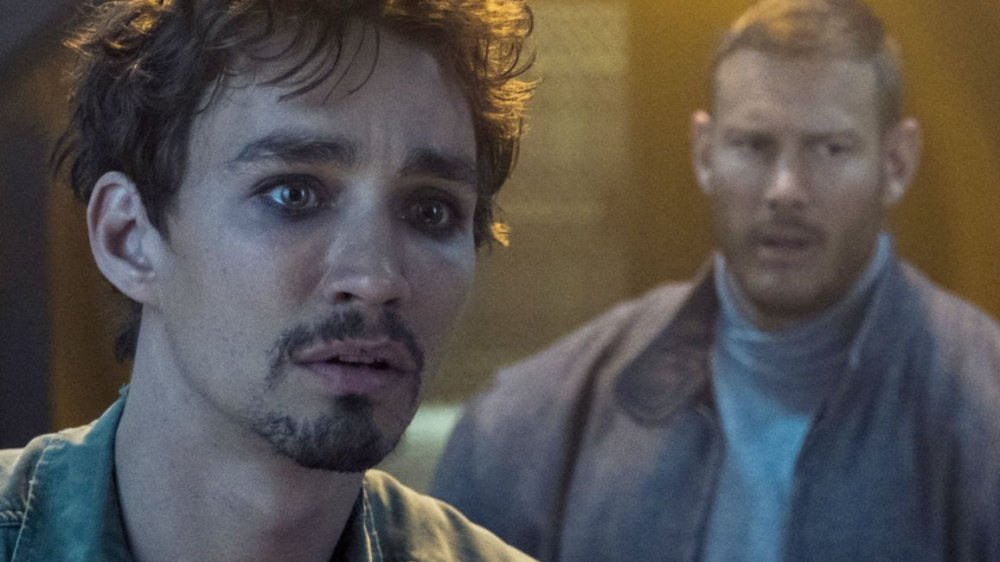Robert Sheehan as Klaus Hargreeves and Tom Hopper as Luther Hargreeves on The Umbrella Academy