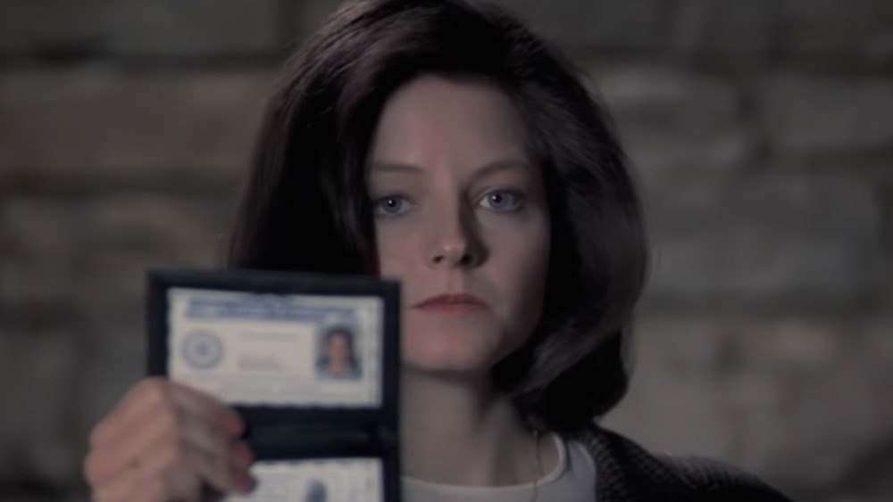 Clarice showing badge