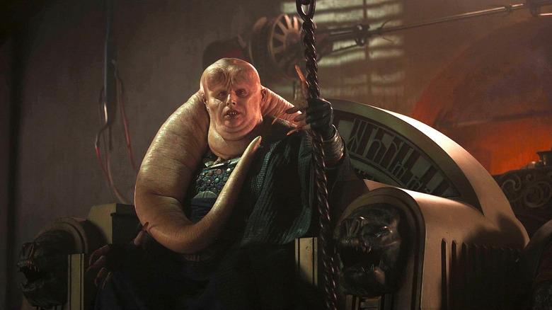 Bib Fortuna seated on Jabba the Hutt's throne
