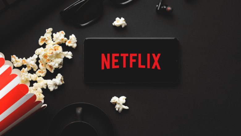Netflix on phone with popcorn