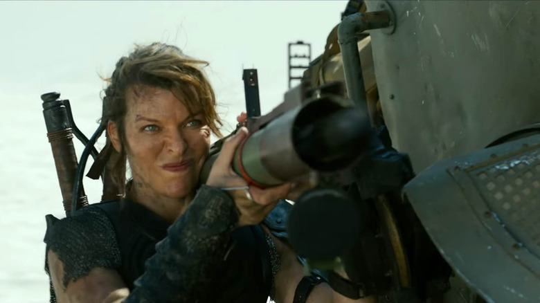 Milla Jovovich holding big gun
