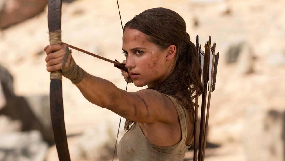 Lara Croft holding a bow and arrow