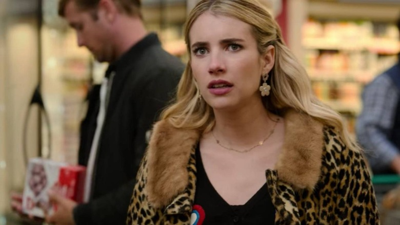 Emma Roberts and an extra who looks like Ryan Gosling star in Netflix's Holidate