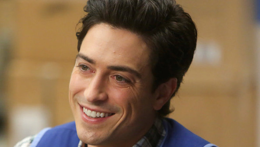 Jonah from Superstore smiling