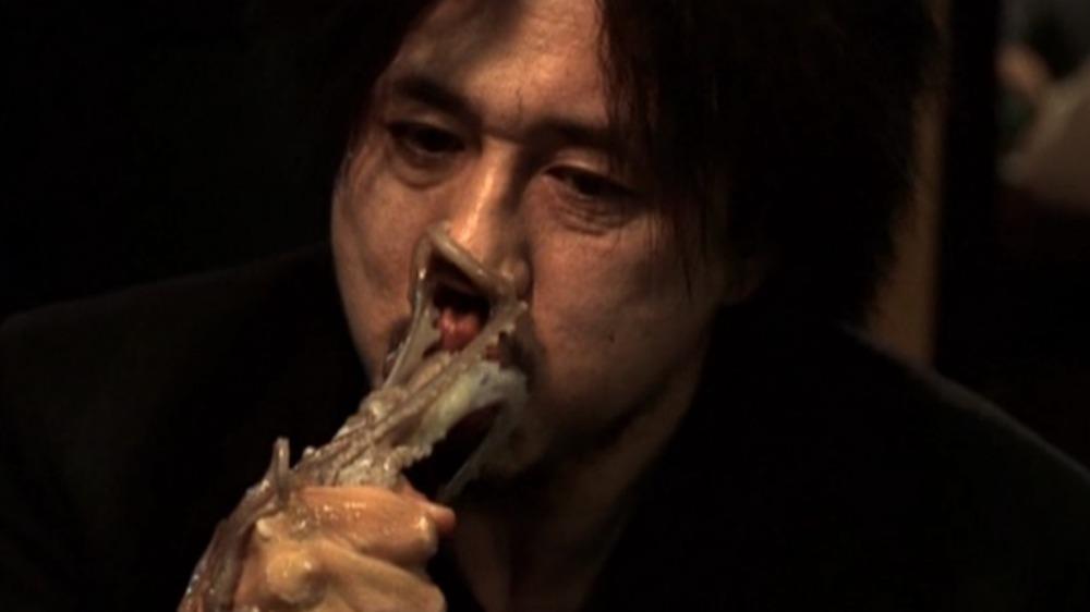 Choi Min-sik eating an octopus