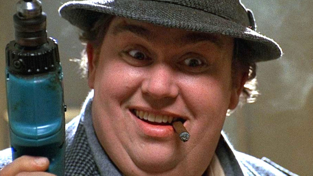 John Candy as Uncle Buck with electric drill smoking a cigar