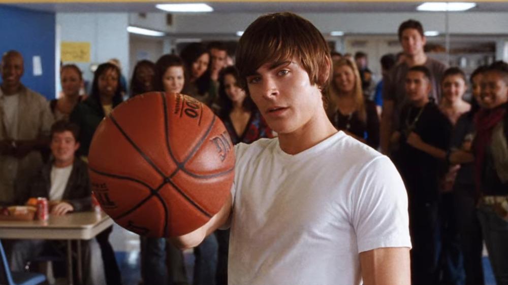 Zac Efron holding basketball