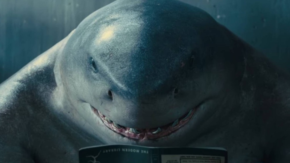 King Shark reads in The Suicide Squad