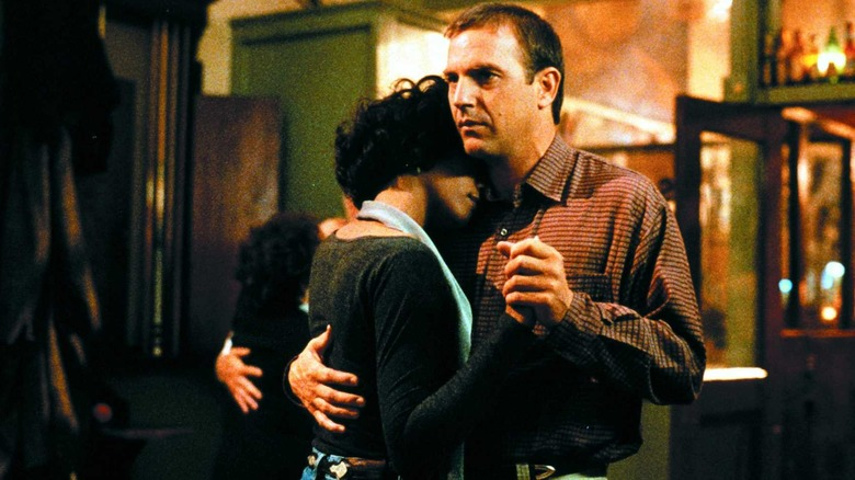 Whitney Houston as Rachel and Kevin Costner as Frank dance in The Bodyguard
