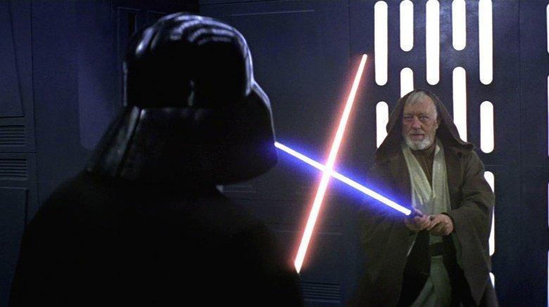 Alec Guiness as Obi-wan Kenobi crossing sabers with Darth Vader