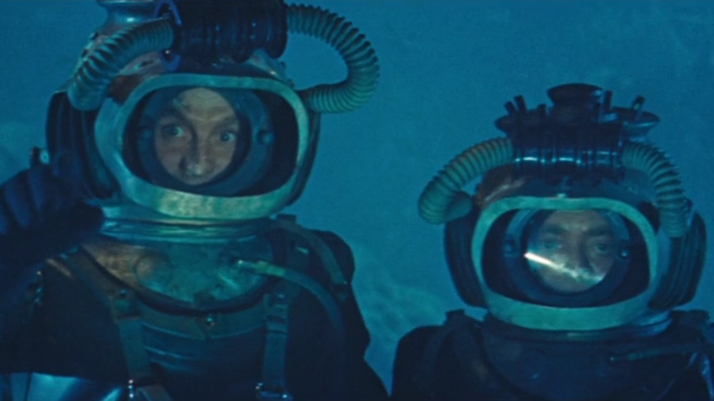 Aronnax and Conseil in metal diving suits