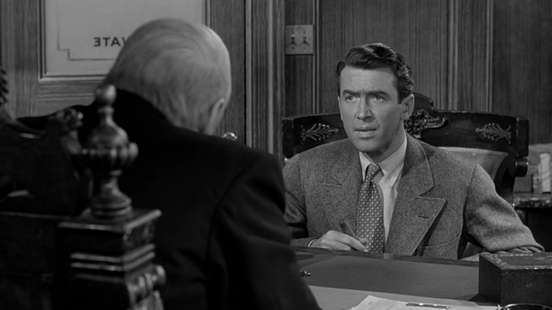 Lionel Barrymore as Mr. Potter and Jimmy Stewart as George in It's a Wonderful Life