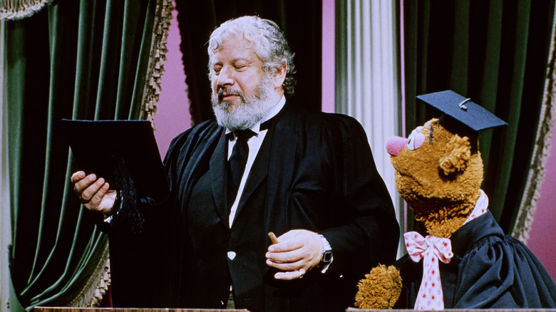 Peter Ustinov and Fozzie Bear in academic robes