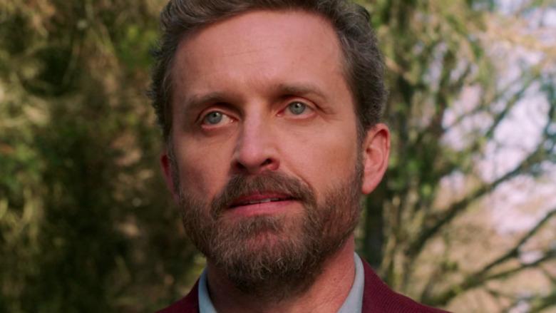 Chuck, aka God, in a red blazer