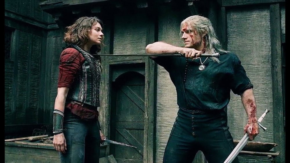 Henry Cavill as Geralt of Rivia, showing a moment's mercy to Emma Appleton's Renfri before she chooses to die
