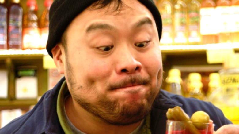 David Chang looking at something delicious
